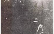 The card shows a man leaning against a lamppost at night in a hazy atmosphere.